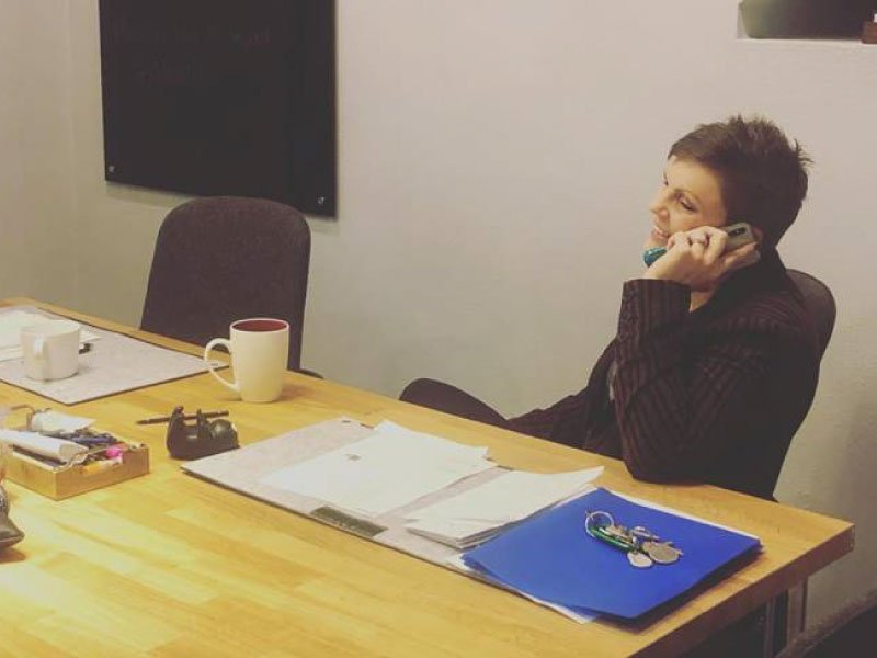 woman on the phone at a conference table